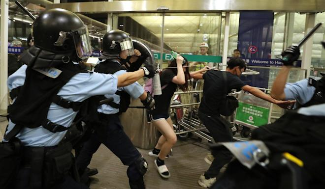 Ugly scenes like this one at Hong Kong International Airport on August 13 have had an impact on passenger numbers. Photo: Sam Tsang