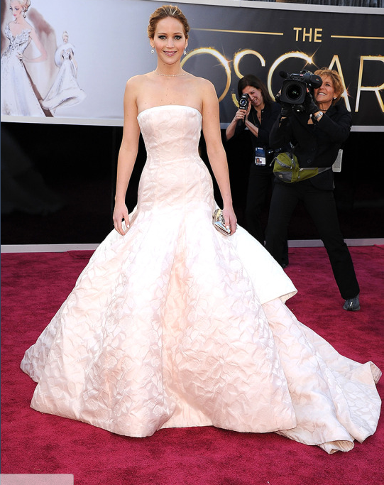 """<p>At age 22, Lawrence becomes the second-youngest Best Actress winner at the <a href=""""https://www.yahoo.com/entertainment/tagged/oscars"""" data-ylk=""""slk:Academy Awards"""" class=""""link rapid-noclick-resp"""">Academy Awards</a> for her role in <i>Silver Linings Playbook</i>. She also charms the nation as she famously tripped on her way up to the stage to accept her Oscar. (Photo: Getty Images) </p>"""