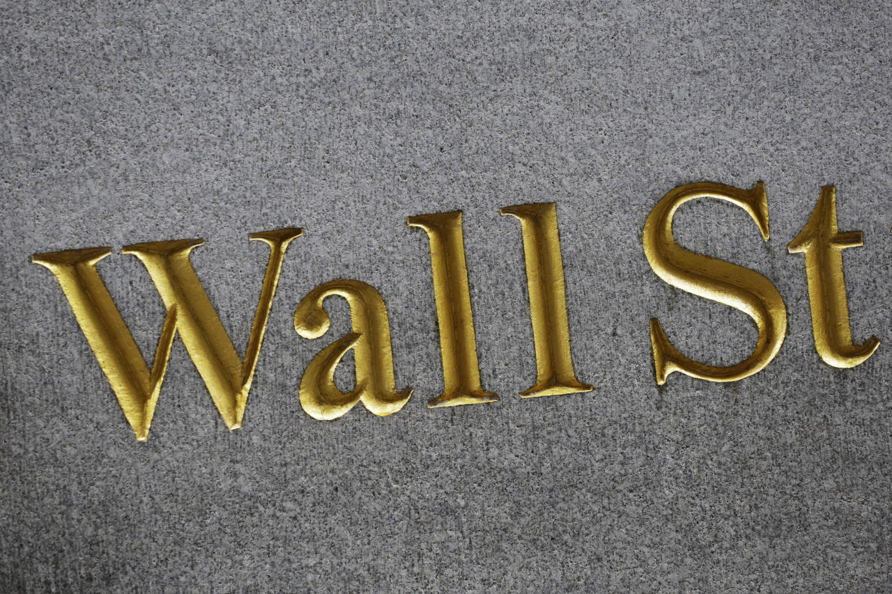 FILE - This Monday, July 6, 2015, file photo shows a sign for Wall Street carved into the side of a building in New York. U.S. stocks are rising early Wednesday, Aug. 16, 2017, as retailers Urban Outfitters and Target climb. That's helping retailers recover some of the sharp losses they took a day earlier. Health care companies and banks are also trading higher. Energy companies are lagging the rest of the market. (AP Photo/Mark Lennihan, File)