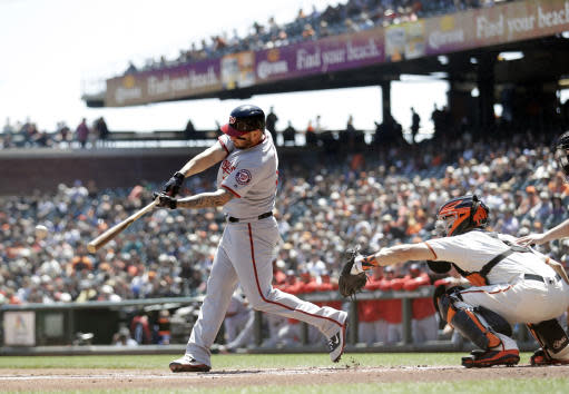 Washington Nationals' Matt Adams hits a single during the first inning of a baseball game against the San Francisco Giants Wednesday, April 25, 2018, in San Francisco. (AP Photo/Marcio Jose Sanchez)