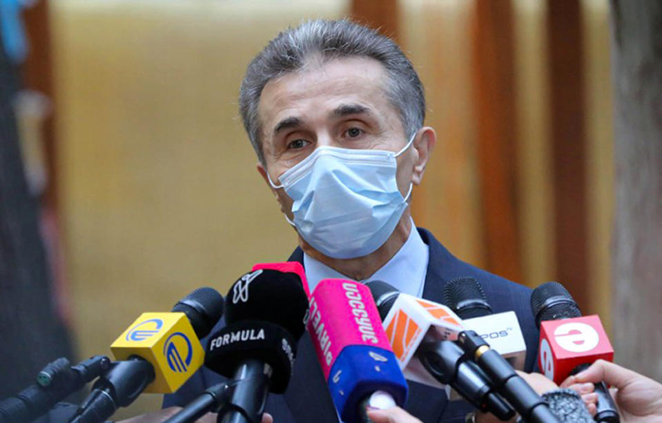 In this handout photo released by Georgian Dream Party Press office, Georgian businessman Bidzina Ivanishvili, who created Georgian Dream party, wearing a face mask to help curb the spread of the coronavirus, speaks to the media after voting at a polling station during the parliamentary elections in Tbilisi, Georgia, Saturday, Oct. 31, 2020. Ivanishvili quickly congratulated his supporters on winning the vote after several exit polls showed his party with a strong lead.(Georgian Dream Party Press office via AP)
