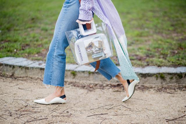 "<p>Aimee Song carries ""Madame Bovary"" inside a clear Staud tote. (Photo: Getty Images) </p>"