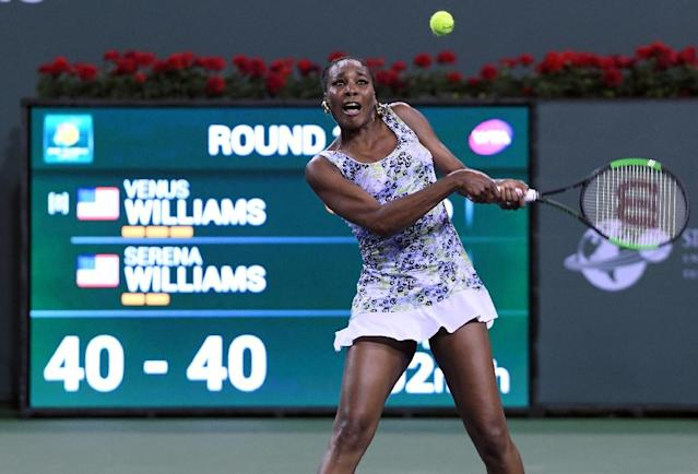 Venus Williams closed out the 29th career match against her sister Serena with a 6-3, 6-4 win at Indian Wells (AFP Photo/KEVORK DJANSEZIAN)