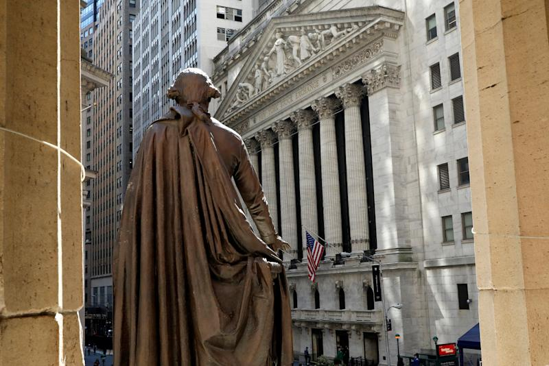 The New York Stock Exchange is seen from the steps of Federal Hall behind a Statue of former U.S. President George Washington in New York City, U.S., May 17, 2017. REUTERS/Brendan McDermid