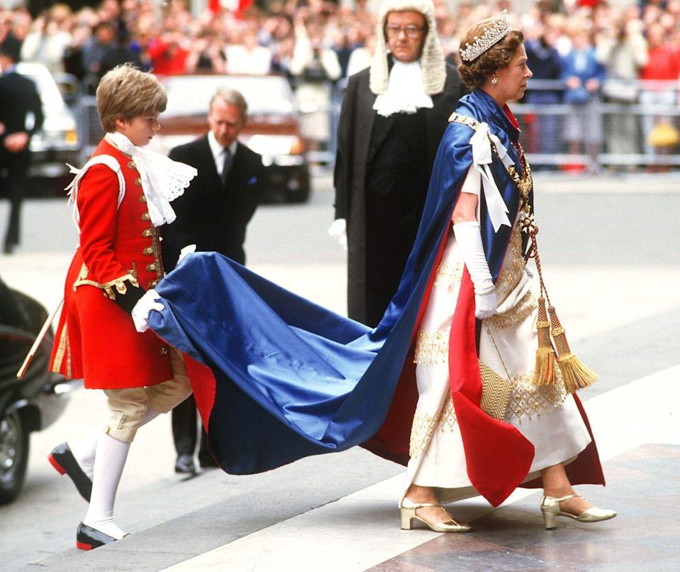 <p>The queen wore a detailed dress, tiara, and a red and blue cape–while a royal page carried the train–when she arrived for a church service at Saint Paul's Cathedral in London.</p>