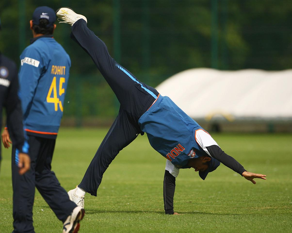 NOTTINGHAM, ENGLAND - JUNE 09:  India captain MS Dhoni cartwheels during a nets session at Lady Bay Cricket Club on June 9, 2009 in Nottingham, England.  (Photo by Matthew Lewis/Getty Images)