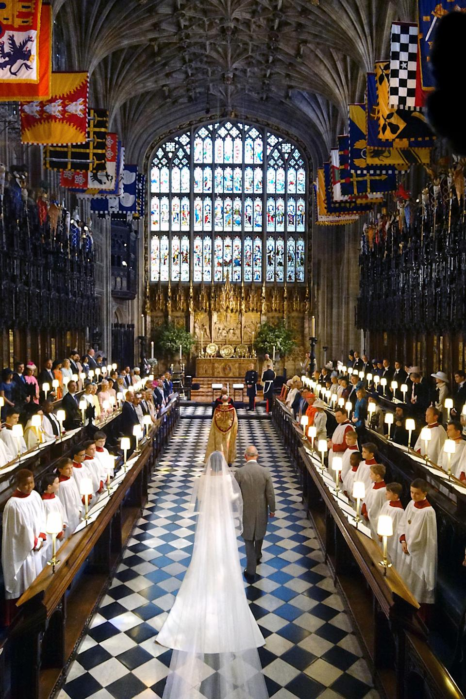 <p>Charles accompanies his daughter-in-law Meghan Markle down the aisle on her wedding day to Prince Harry in May 2018 (PA) </p>