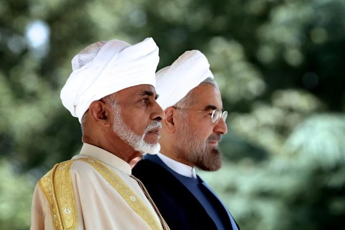 Qaboos maintained good ties with Iran, whose President Hassan Rouhani he is seen here meeting in August 2013 (AFP Photo/Behrouz MEHRI)