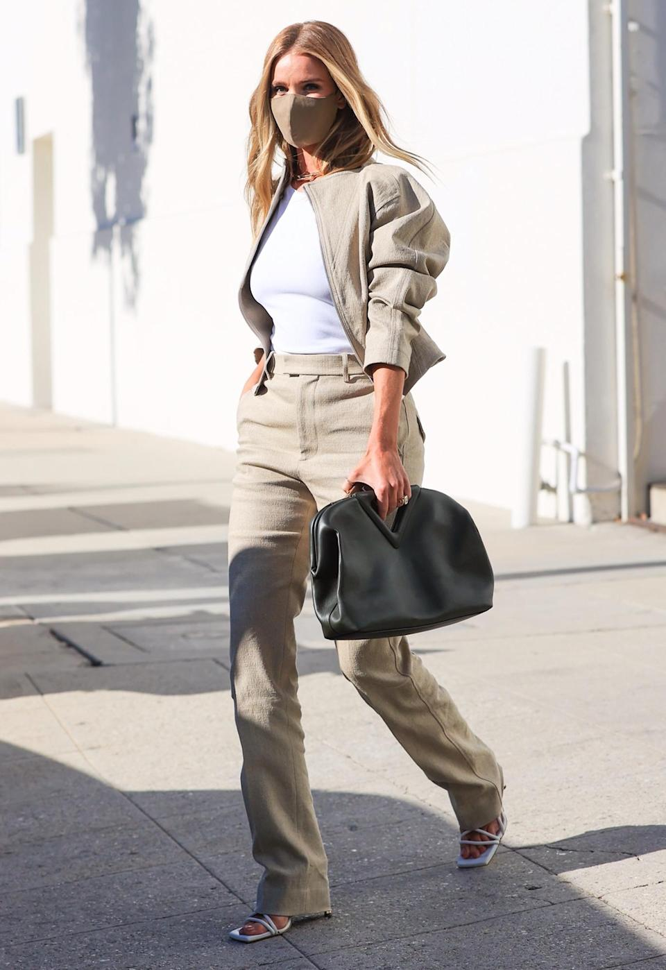<p>Rosie Huntington-Whiteley looks every inch the model while leaving Milk Studios in L.A. on Wednesday.</p>