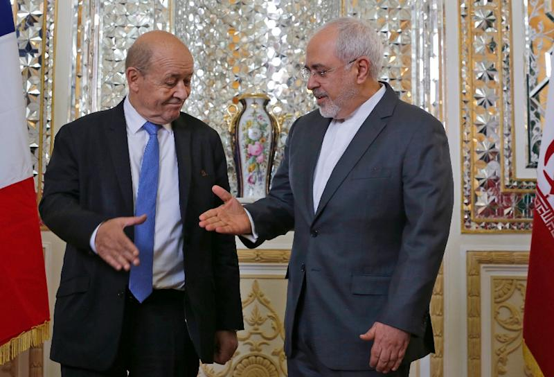 Iran's Foreign Minister Mohammad Javad Zarif (R) shakes hands with French Foreign Minister Jean-Yves Le Drian as they meet in the capital Tehran on March 5, 2018. (AFP Photo/ATTA KENARE)
