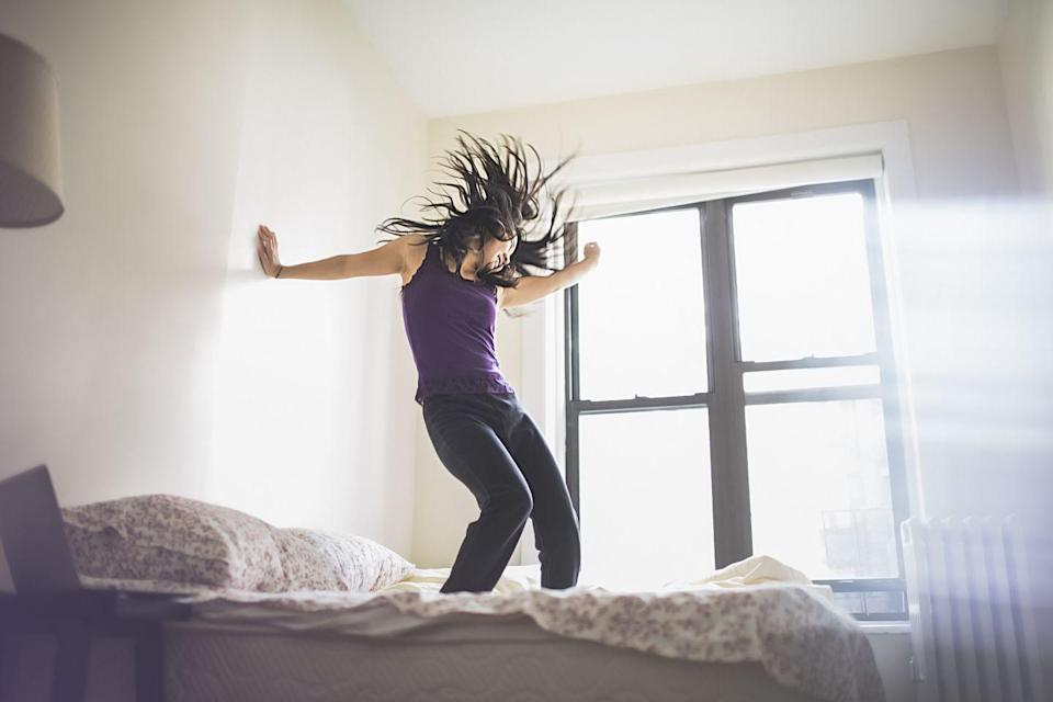 """<p>Dancing feels good, and you definitely don't need to be in a club or out at a party in order to do it. If you need an instant mood boost, put on some of your favorite songs and dance around your house. Bonus: you don't need to stress over who is watching you. </p><p>Several studies have shown that dancing can lead to feelings of happiness. One study done in Poland <a href=""""https://www.tandfonline.com/doi/abs/10.1080/17461391.2014.969324"""" rel=""""nofollow noopener"""" target=""""_blank"""" data-ylk=""""slk:looked at the moods"""" class=""""link rapid-noclick-resp"""">looked at the moods</a> before and after dance activity among competitive and recreational dancers. Competitive dancers felt stressed (like any other professional athlete), but the recreational dancers reported more energy, less tension, and a better overall mood. Another study found that <a href=""""https://www.researchgate.net/publication/323143442_PHYSIOLOGICAL_RESPONSES_OF_ZUMBA_AN_OVERVIEW_UNDERSTANDING_THE_POPULAR_FITNESS_TREND"""" rel=""""nofollow noopener"""" target=""""_blank"""" data-ylk=""""slk:doing Zumba"""" class=""""link rapid-noclick-resp"""">doing Zumba</a> (fitness dance classes) achieved similar results and can even improve memory.<br></p>"""