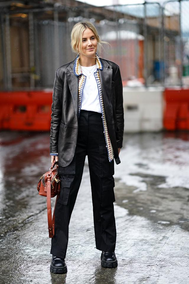 <p>For a fashion girl outfit, style yours with a tucked tee, leather jacket, and chunky boots.</p>