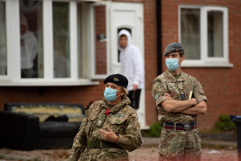 RAF personnel in Selly Oak, close to the University of Birmingham, assisting with Birmingham City Council's 'Drop and Collect' coronavirus test distribution, as the local authority attempt to stem the rise of cases in the area.