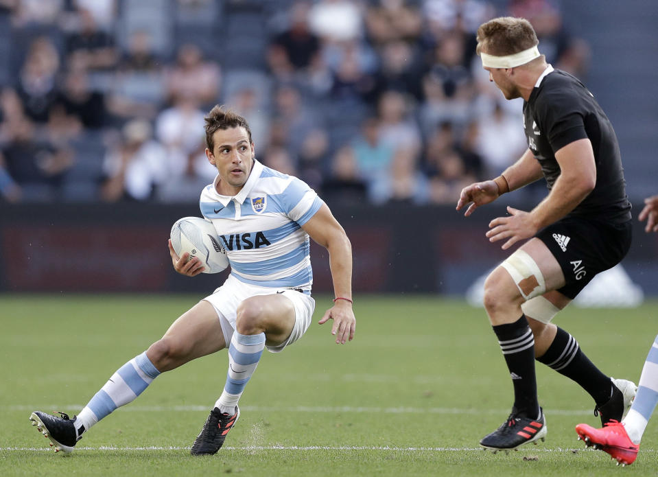 Argentina's Nicolas Sanchez, left, looks to get past New Zealand's Sam Cane, during their Tri-Nations rugby union test at Western Sydney Stadium, in Sydney, Saturday, Nov. 14, 2020. Argentina won the test 25-15. (AP Photo/Rick Rycroft)