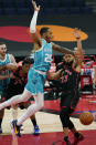 Charlotte Hornets forward P.J. Washington (25) loses the ball as he drives into Toronto Raptors guard Fred VanVleet (23) during the first half of an NBA basketball game Saturday, Jan. 16, 2021, in Tampa, Fla. (AP Photo/Chris O'Meara)