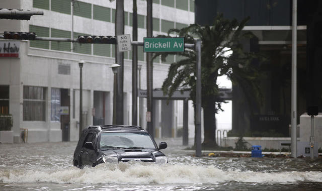 <p><strong>Miami</strong><br> A vehicle drives on flooded Brickell Avenue in Miami on Sept. 10, 2017, as Hurricane Irma passes. (Photo: Mike Stocker/South Florida Sun-Sentinel via AP) </p>