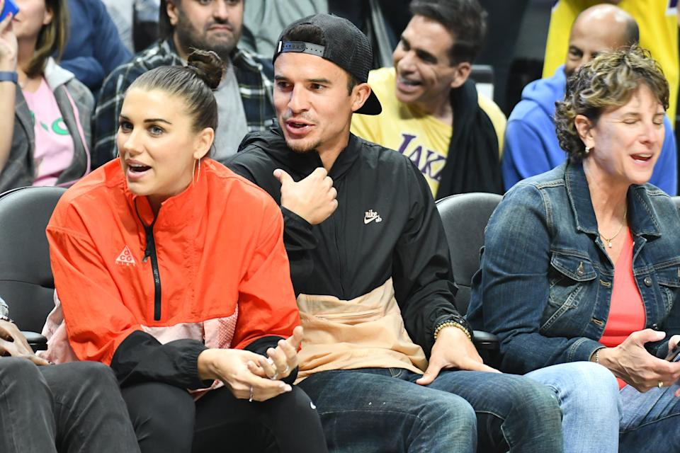 LOS ANGELES, CALIFORNIA - OCTOBER 22: Alex Morgan and Servando Carrasco attend a basketball game between the Los Angeles Clippers and the Los Angeles Lakers at Staples Center on October 22, 2019 in Los Angeles, California. (Photo by Allen Berezovsky/Getty Images)