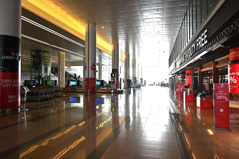 A general view of the nearly empty arrival hall of Noi Bai International Airport in Hanoi on February 27, 2020, as the number of air travellers has plummeted amid fears over the spread of the COVID 19 coronavirus. 2