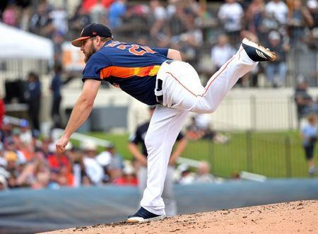 Mar 20, 2019; West Palm Beach, FL, USA; Houston Astros starting pitcher Wade Miley (20) throws against the New York Yankees during a spring training game at FITTEAM Ballpark of the Palm Beaches. Mandatory Credit: Steve Mitchell-USA TODAY Sports