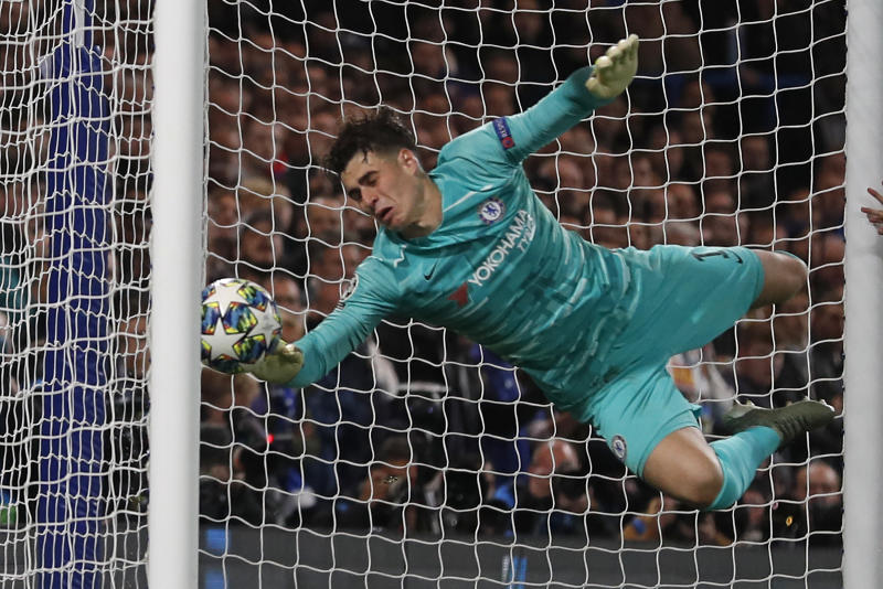 Chelsea's Spanish goalkeeper Kepa Arrizabalaga diverts the ball into his own net for Ajax's third goal during the UEFA Champion's League Group H football match between Chelsea and Ajax at Stamford Bridge in London on November 5, 2019. (Photo by Adrian DENNIS / AFP) (Photo by ADRIAN DENNIS/AFP via Getty Images)