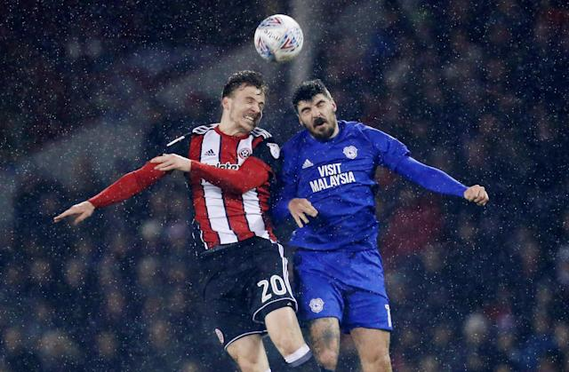 "Soccer Football - Championship - Sheffield United vs Cardiff City - Bramall Lane, Sheffield, Britain - April 2, 2018 Sheffield United's Lee Evans and Cardiff City's Callum Paterson in action Action Images/Ed Sykes EDITORIAL USE ONLY. No use with unauthorized audio, video, data, fixture lists, club/league logos or ""live"" services. Online in-match use limited to 75 images, no video emulation. No use in betting, games or single club/league/player publications. Please contact your account representative for further details."