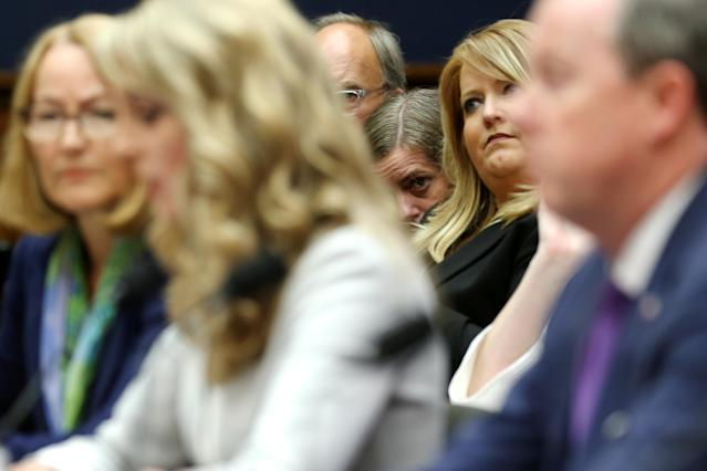 Members of the gallery look on from the front row as USOC acting chief Susanne Lyons, USA Gymnastics CEO Kerry Perry and USA Swimming CEO Tim Hinchey testify at a House Energy and Commerce Committee hearing on Olympic athletes and sexual abuse on Capitol Hill in Washington, U.S., May 23, 2018. REUTERS/Jonathan Ernst
