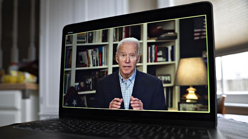 Former Vice President Joe Biden, 2020 Democratic presidential candidate, speaks during a virtual press briefing on a laptop computer in this arranged photograph in Arlington, Virginia, U.S., on Wednesday, March 25, 2020. (Andrew Harrer/Bloomberg via Getty Images)