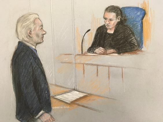 A court sketch showing Julain Assange addressing district judge Vanessa Baraitser (PA)