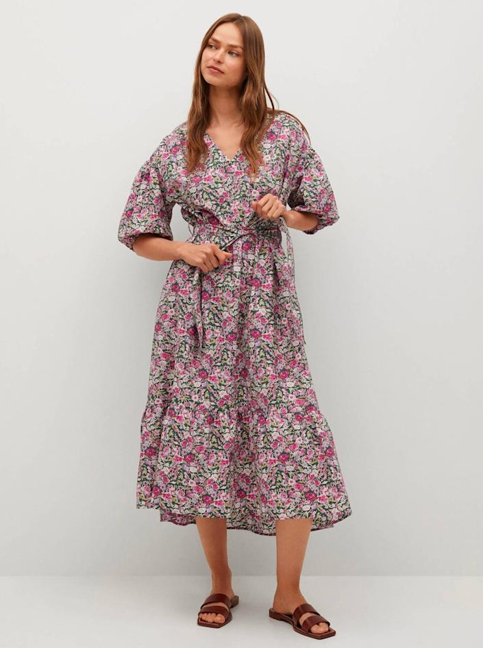 """Don't sleep on Mango if you're looking to save some coin. The celebrity-approved retailer consistently comes through with elevated designs for less, including this under-$100 prairie dress that's perfect for a park ceremony. $80, Mango. <a href=""""https://shop.mango.com/us/women/dresses-and-jumpsuits-midi/flowers-cotton-dress_87065665.html"""" rel=""""nofollow noopener"""" target=""""_blank"""" data-ylk=""""slk:Get it now!"""" class=""""link rapid-noclick-resp"""">Get it now!</a>"""