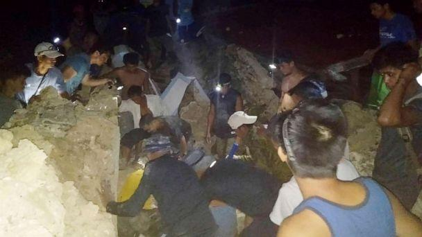 PHOTO: Rescuer teams search for survivors following two earthquakes that struck the northernmost island of Itbayat, Batanes province in northern Philippines, July 27, 2019. (Philippine Coast Guard Via AP)