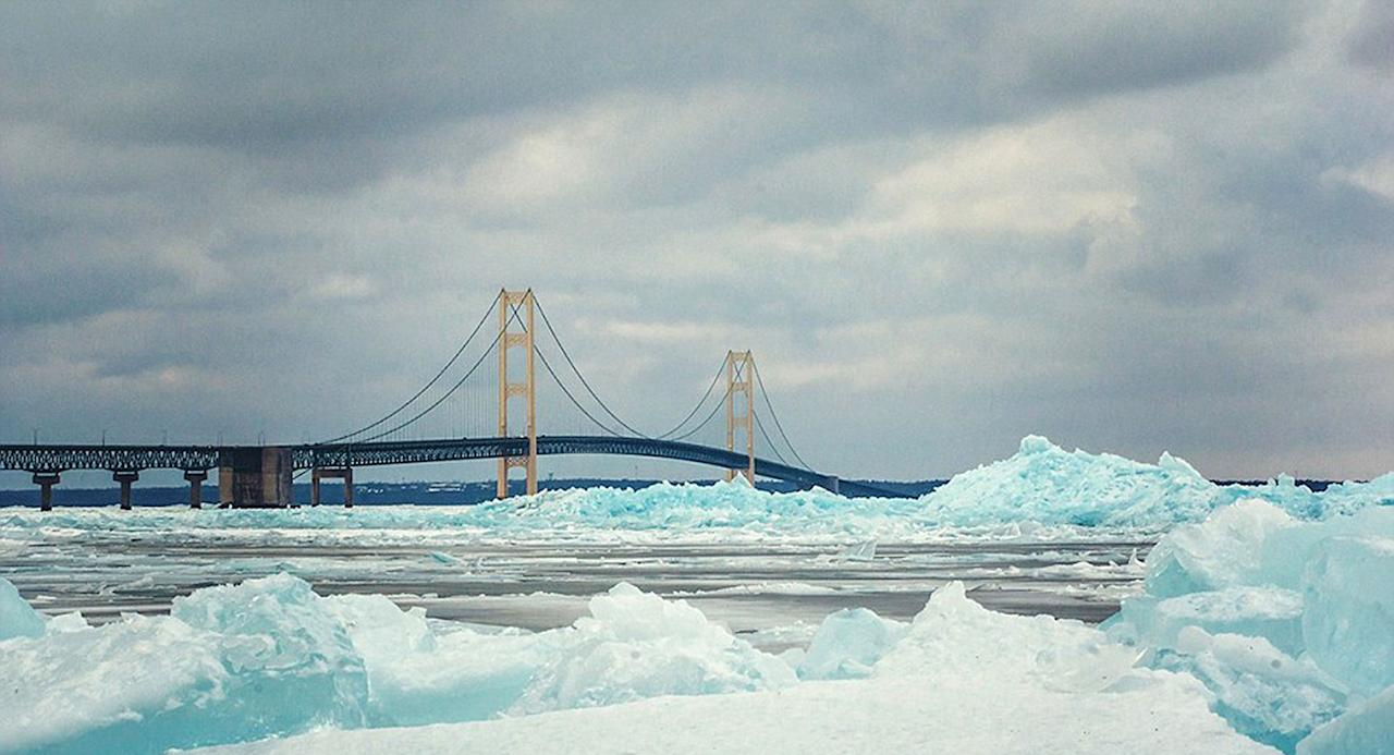 <p>Over the weekend, photographers and nature-lovers across Michigan flocked to the Mackinac Bridge to see the stunning blocks of blue ice that had formed around the structure.</p>