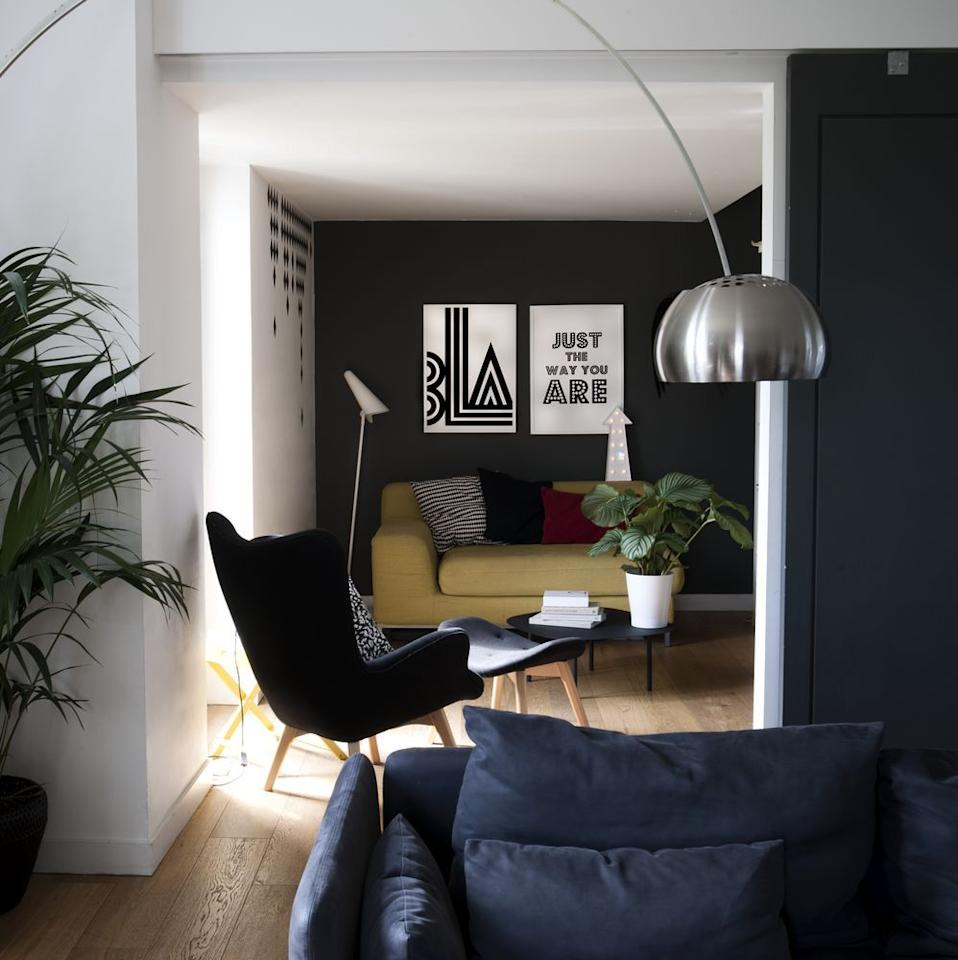 "<p>Adopt a minimal approach to interior design with a look similar to this cosy seating area in a three-bedroom farmhouse on the outskirts of Edinburgh. Dark charcoal walls define the space, while a pale mustard loveseat provides the perfect contrast, and bold art prints add interest.</p><p>Pictured: <a href=""https://www.housebeautiful.com/uk/renovate/homes-makeovers/a2889/scottish-farmhouse-edinburgh-modern-home/"" target=""_blank"">Inside a renovated Scottish farmhouse influenced by Scandi design</a></p>"