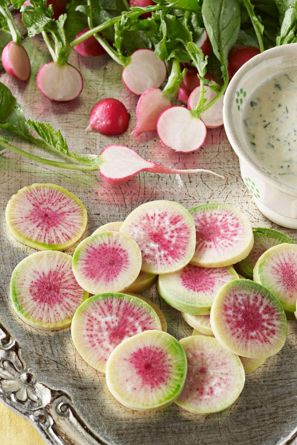 "<p>Radishes dipped in butter is a classic French recipe. This inspired dish takes tradition one step further by replacing the butter with a dip made of zesty horseradish, tangy buttermilk, and fresh green herbs.</p><p><strong><a href=""https://www.countryliving.com/food-drinks/recipes/a3650/sliced-radishes-horseradish-buttermilk-dip-recipe-clx0411/"" rel=""nofollow noopener"" target=""_blank"" data-ylk=""slk:Get the recipe"" class=""link rapid-noclick-resp"">Get the recipe</a>.</strong></p>"