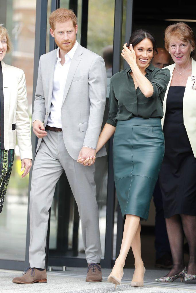 "<p>The Duke and Duchess happily held hands <a href=""https://www.townandcountrymag.com/society/tradition/g23573050/prince-harry-meghan-markle-visit-sussex-photos/"" rel=""nofollow noopener"" target=""_blank"" data-ylk=""slk:while greeting crowds in Sussex."" class=""link rapid-noclick-resp"">while greeting crowds in Sussex. </a></p>"