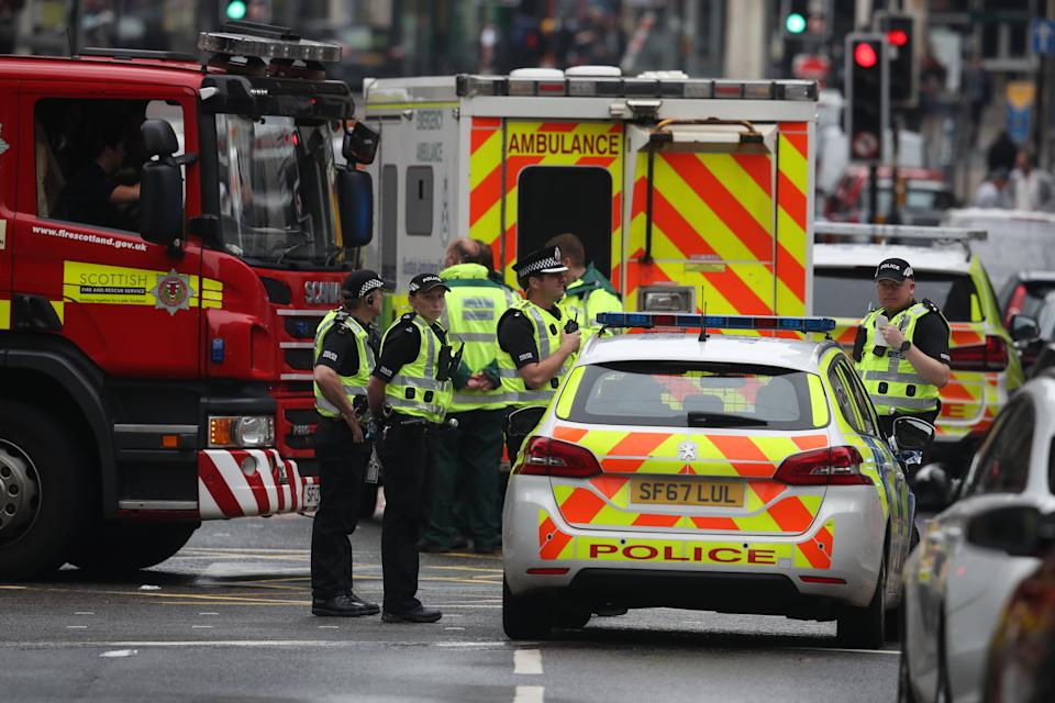 Emergency services at the scene in West George Street, Glasgow, where a man has been shot by an armed officer after another police officer was injured during an attack.