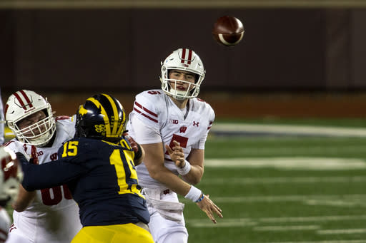 Wisconsin quarterback Graham Mertz (5) throws a pass in the first quarter of an NCAA college football game against Michigan in Ann Arbor, Mich., Saturday, Nov. 14, 2020. (AP Photo/Tony Ding)