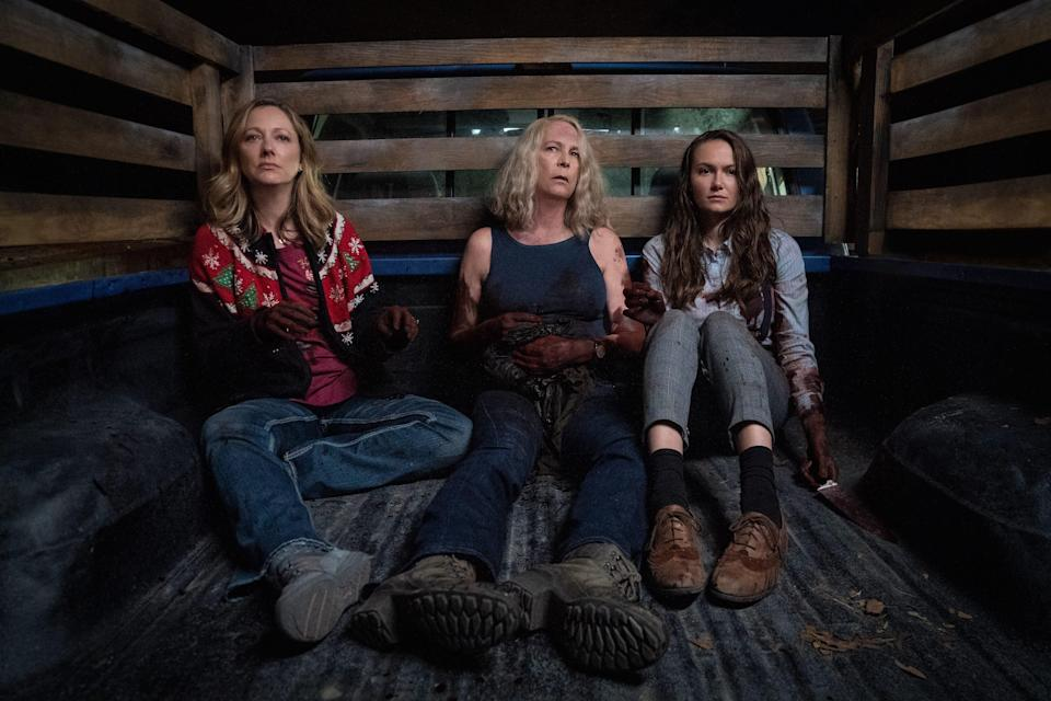 """Laurie Strode (Jamie Lee Curtis, center with Judy Greer and Andi Matichak) is bleeding out at the beginning of """"Halloween Kills."""""""