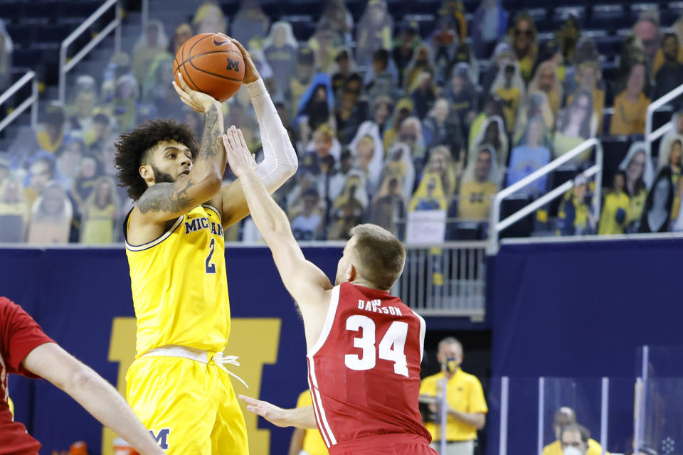 Jan 12, 2021; Ann Arbor, Michigan, USA;  Michigan Wolverines forward Isaiah Livers (2) shoots against Wisconsin Badgers guard Brad Davison (34) in the first half at Crisler Center. Mandatory Credit: Rick Osentoski-USA TODAY Sports