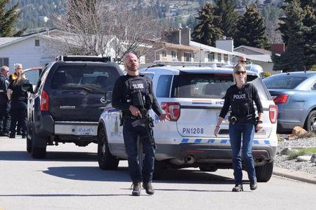 Royal Canadian Mounted Police (RCMP) officers attend a crime scene on Cornwall Drive, after a series of attacks in which four people were shot dead, in Penticton