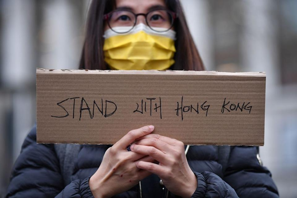 <p>A protester mourns the loss of Hong Kong's political freedoms</p> (AFP via Getty Images)