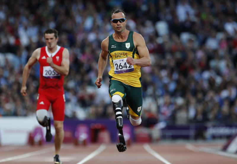 """FILE - In this Wednesday, Sept. 5, 2012 file photo, South Africa's Oscar Pistorius competes during Men's 100m T44 round 1 at the 2012 Paralympics in London. Olympic sprinter Oscar Pistorius has been arrested after a 30-year-old woman was shot dead at his home in South Africa. Police say Pistorius, a double-amputee known as """"Blade Runner,"""" was taken into custody after the shooting early Thursday, Feb. 14, 2013, at his home in a gated complex in the country's capital. (AP Photo/Emilio Morenatti, File)"""