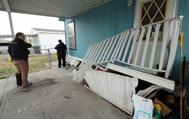 PHOTO: Members of law enforcement survey damage to a mobile home at Western Estates in Magna, Utah, after 5.7-magnitude earthquake had shaken Salt Lake City and many of its suburbs, March 18, 2020. (Jeffrey D. Allred/The Deseret News via AP)