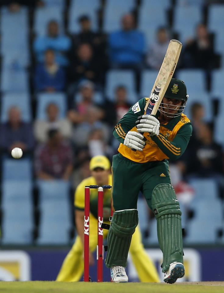 South Africa's Quinton de Kock plays a shot during the final of the T20 cricket test match against Australia in Centurion, March 14, 2014. REUTERS/Siphiwe Sibeko (SOUTH AFRICA - Tags: SPORT CRICKET)
