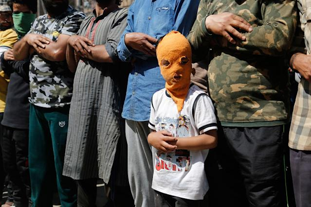 <p>A young masked Kashmiri protester participates in funeral prayers in absentia for rebel commander and his associate killed in a gunbattle, in Srinagar, India, Saturday, May 27, 2017. One civilian was killed and dozens of others injured Saturday after massive anti-India protests and clashes erupted in Indian-controlled Kashmir following the killing of a prominent rebel commander and his associate in a gunbattle with government forces in the disputed region. (Photo: Mukhtar Khan/AP) </p>