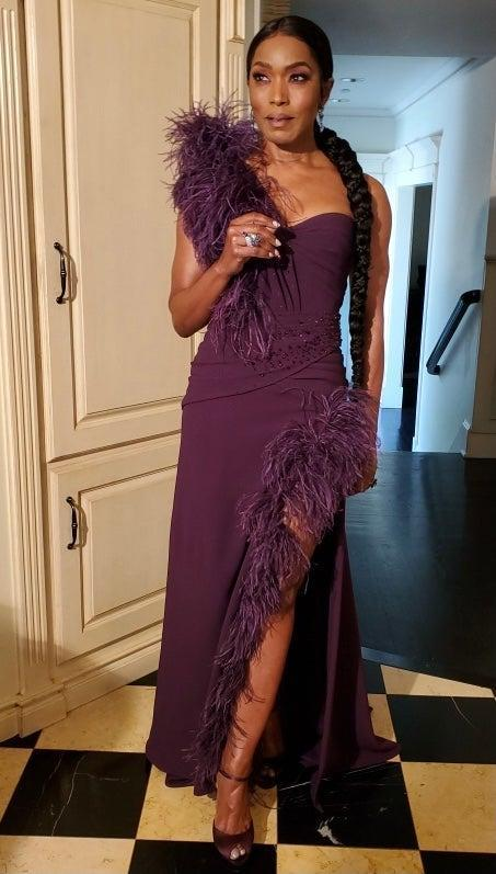 """<h2>Angela Bassett in Dolce & Gabbana</h2><br>When else are you going to wear a purple, feathered gown during a pandemic if not for the Golden Globes? <br><br><span class=""""copyright"""">Photo Credit: Jennifer Austin.</span>"""