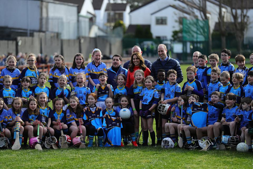 The Duke and Duchess of Cambridge poses for a group photograph during a visit to Salthill Knocknacarra GAA Club in Galway, where they will learn more about traditional sports during the third day of their visit to the Republic of Ireland. (Photo by Aaron Chown/PA Images via Getty Images)