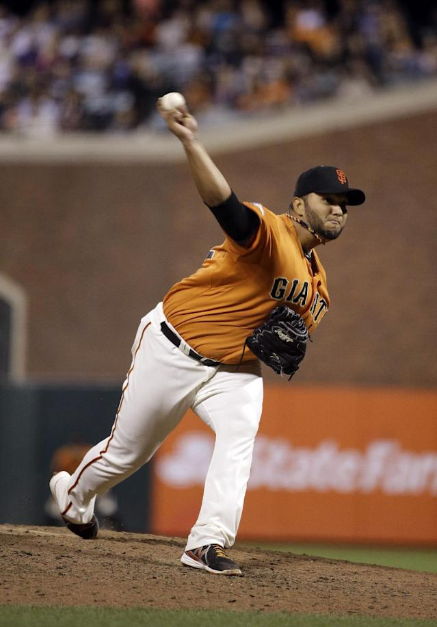 San Francisco Giants starting pitcher Yusmeiro Petit throws against the Arizona Diamondbacks in the seventh inning of their baseball game Friday, Sept. 6, 2013, in San Francisco. (AP Photo/Eric Risberg)