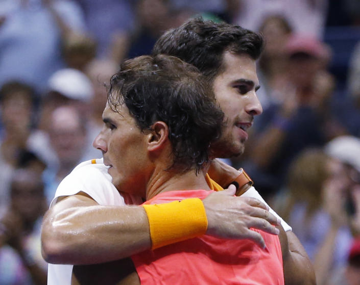 Rafael Nadal, of Spain, hugs Karen Khachanov, of Russia, after Nadal defeated Khachanov during the third round of the U.S. Open tennis tournament, Friday, Aug. 31, 2018, in New York. (AP Photo/Jason DeCrow)