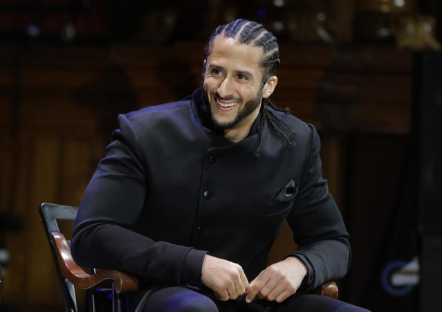 FILE - In this Oct. 11, 2018, file photo, former NFL football quarterback Colin Kaepernick smikes on stage during W.E.B. Du Bois Medal ceremonies at Harvard University, in Cambridge, Mass. Colin Kaepernick wants to play in the NFL, even if he has to compete to get on the field. A source close to Kaepernick told The Associated Press on Friday: Colin has always been prepared to compete at the highest level and is in the best shape of his life. Kaepernick released a video earlier this week saying: 5 a.m. 5 days a week. For 3 years. Still Ready. (AP Photo/Steven Senne, File)