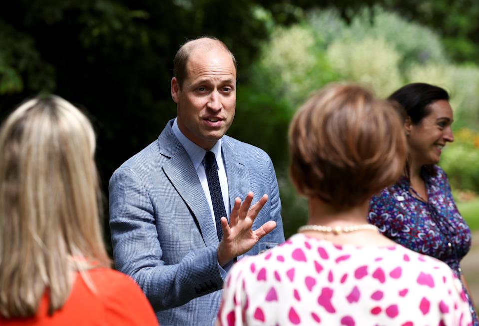 Prince William attends a tea party to celebrate the NHS' birthday at Buckingham Palace (REUTERS)